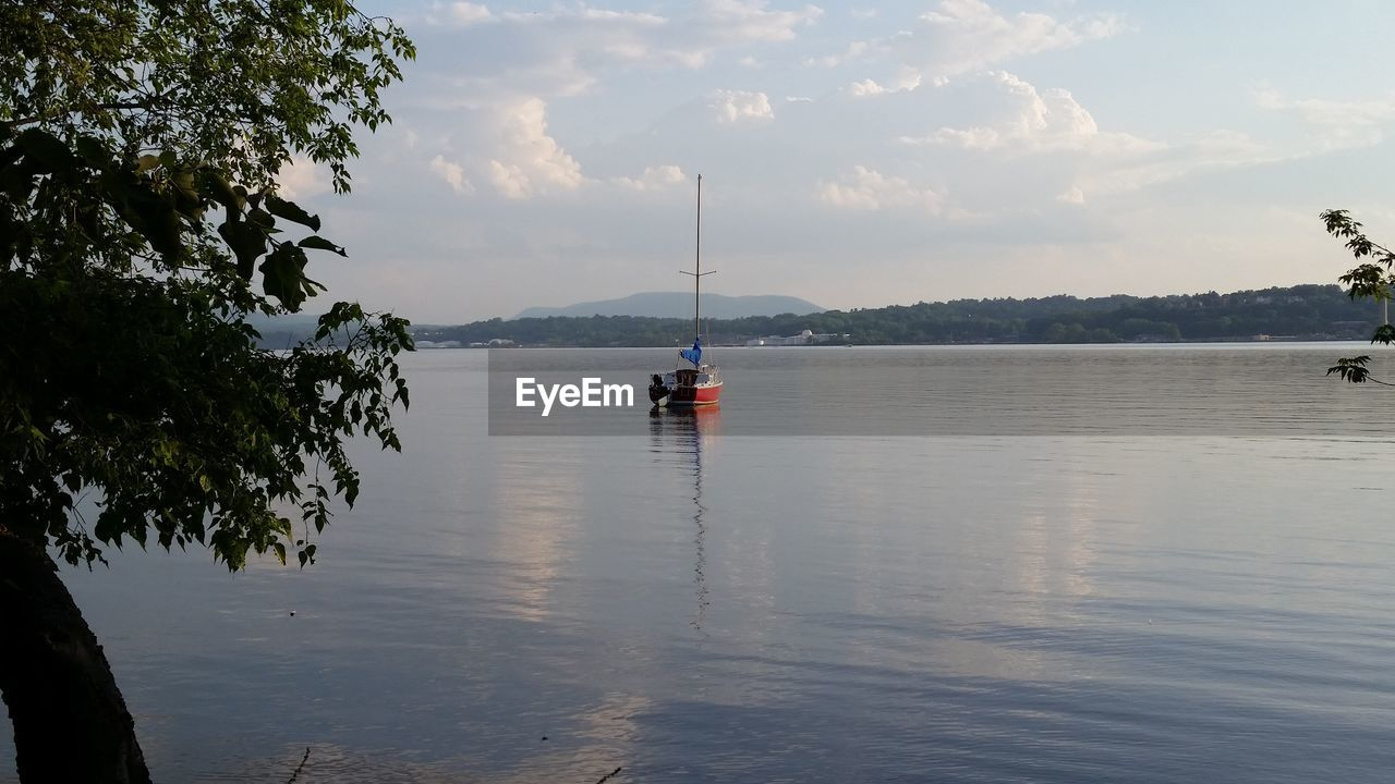 water, sky, transportation, scenics, nautical vessel, beauty in nature, tranquil scene, tranquility, nature, mode of transport, reflection, cloud - sky, waterfront, tree, outdoors, day, no people, lake