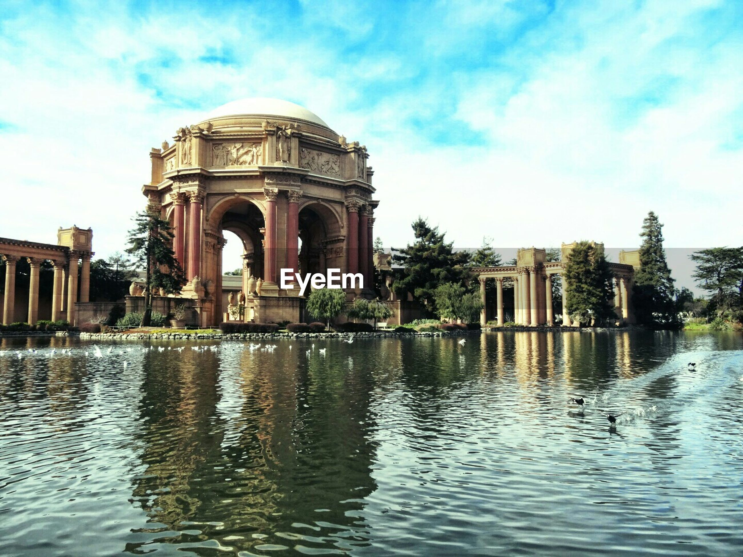 Palace of fine arts against cloudy sky