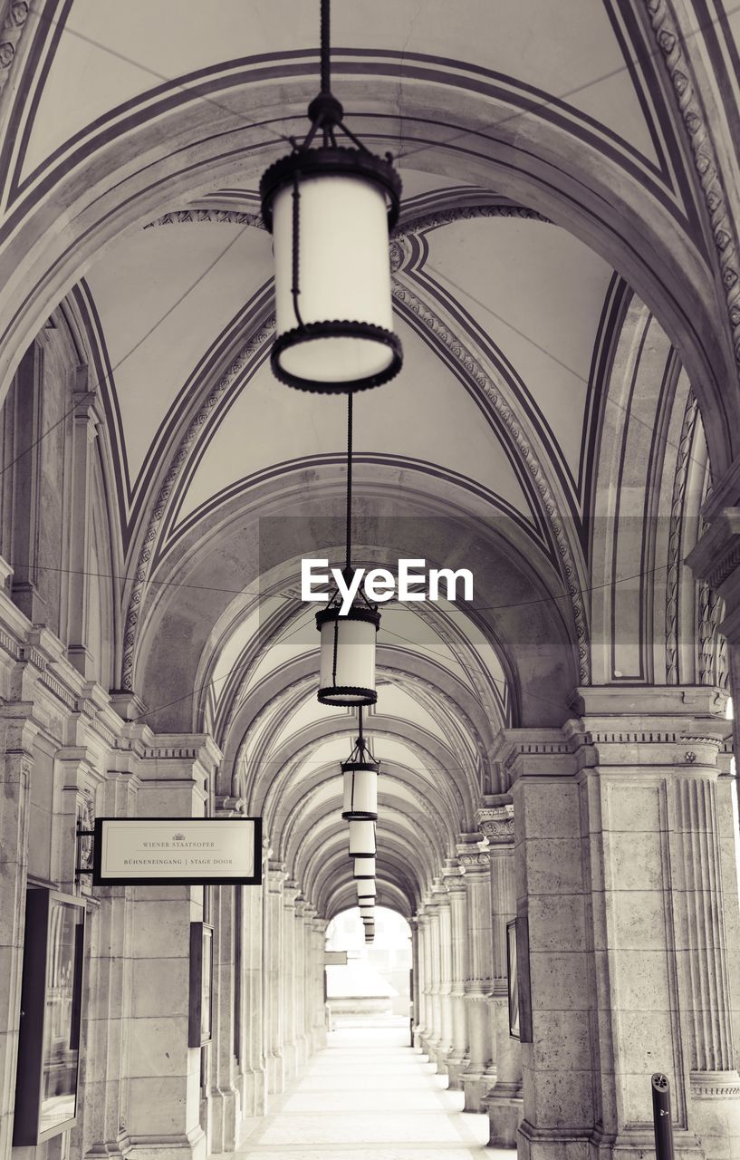 arch, architecture, built structure, indoors, direction, lighting equipment, the way forward, ceiling, day, in a row, no people, building, architectural column, arcade, hanging, empty, corridor, diminishing perspective, pendant light, electric lamp, colonnade, arched, ornate