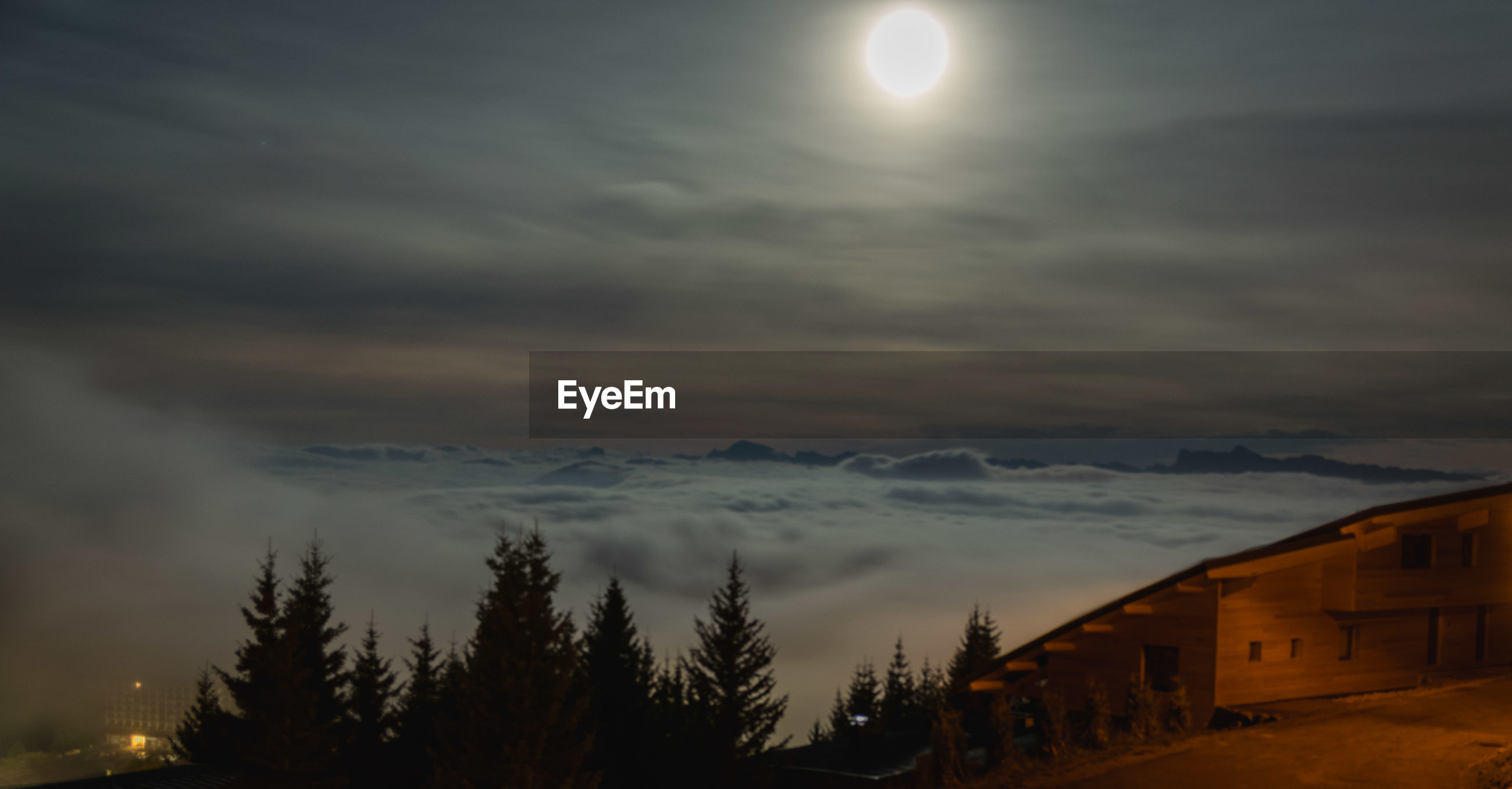 SCENIC VIEW OF SNOWCAPPED MOUNTAINS AGAINST SKY DURING NIGHT