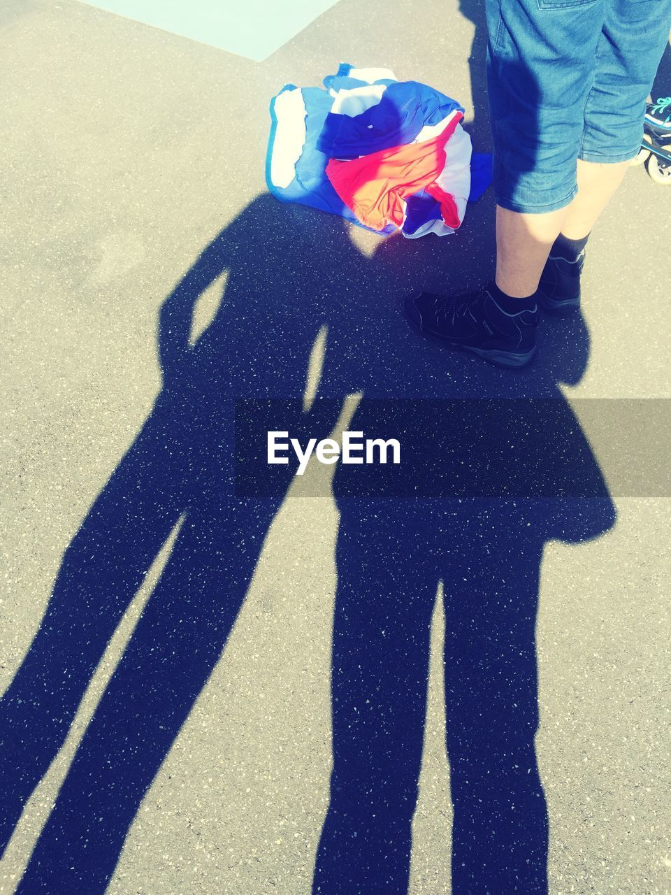 shadow, real people, high angle view, sunlight, street, childhood, togetherness, men, day, outdoors, two people, low section, people