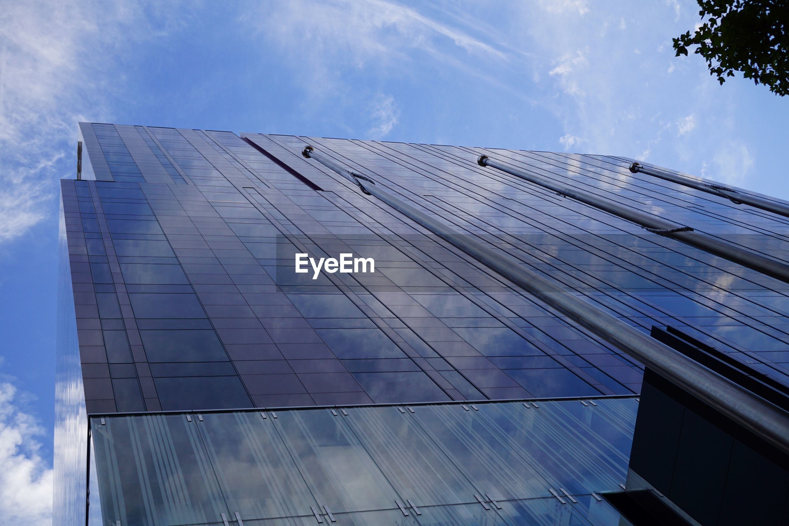 architecture, sky, built structure, building exterior, low angle view, cloud - sky, modern, glass - material, building, city, office building exterior, day, reflection, no people, office, nature, tall - high, outdoors, skyscraper, tower