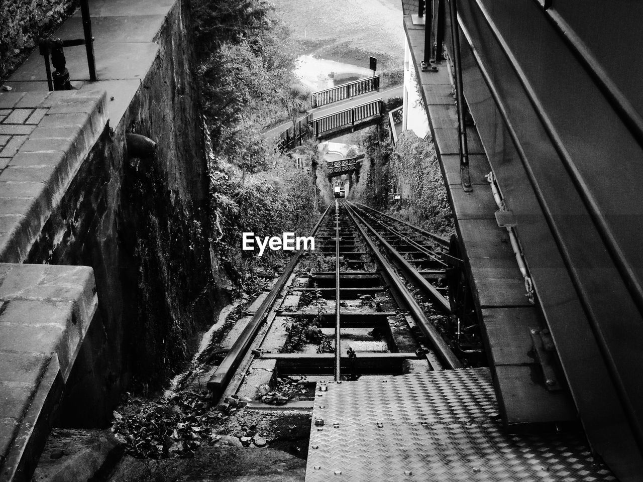 architecture, railroad track, high angle view, built structure, rail transportation, staircase, track, transportation, steps and staircases, public transportation, mode of transportation, incidental people, building exterior, railing, illuminated, direction, the way forward, outdoors, city, travel