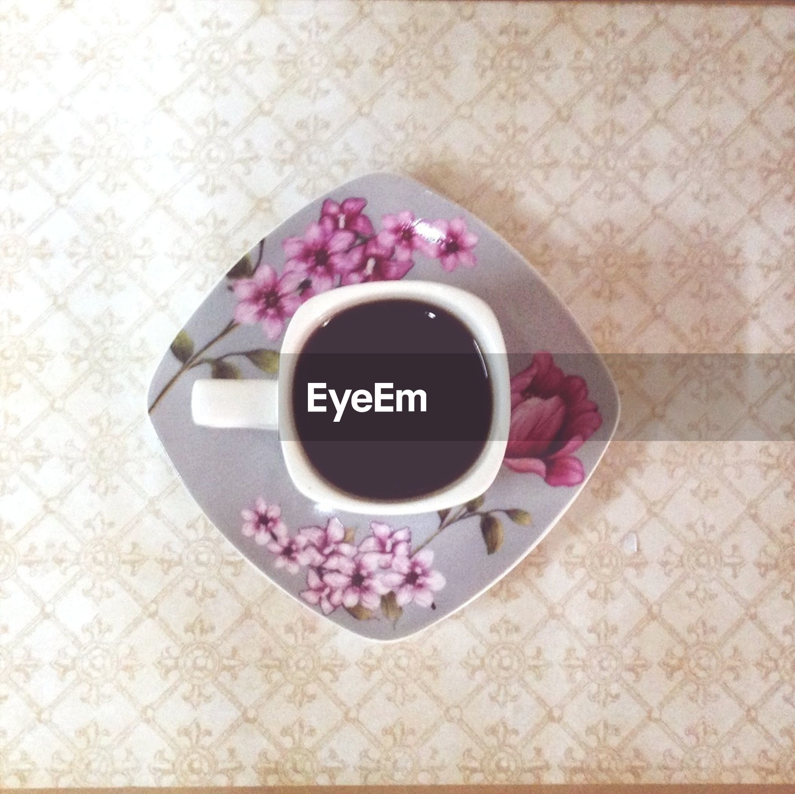 coffee cup, food and drink, indoors, table, drink, freshness, refreshment, saucer, coffee - drink, high angle view, still life, cup, coffee, directly above, flower, spoon, tea cup, tablecloth, overhead view, tea
