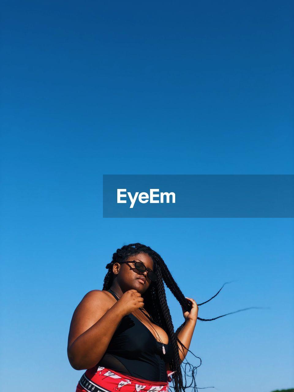 A peng black girl basking in the african sun