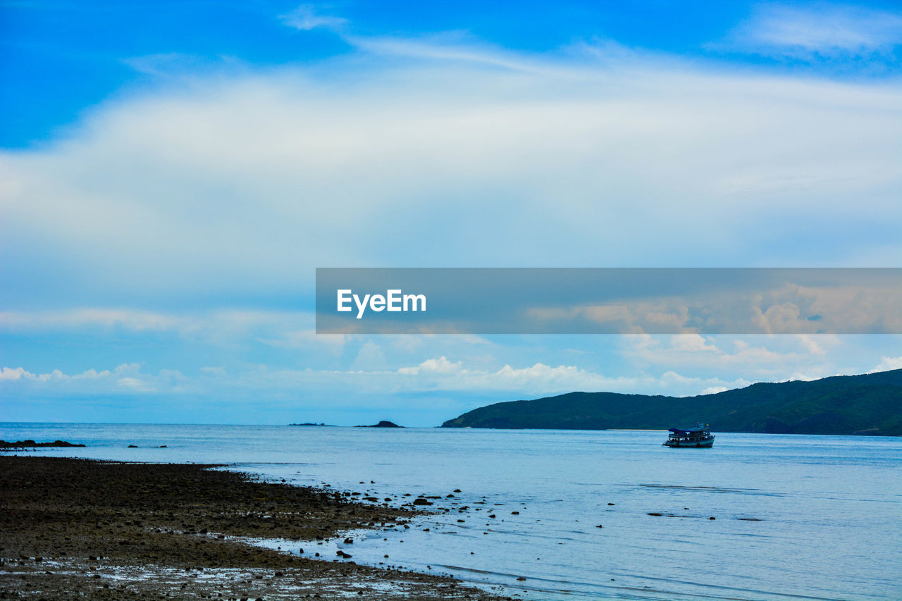water, sky, scenics - nature, sea, cloud - sky, beauty in nature, tranquility, nautical vessel, beach, land, tranquil scene, nature, day, transportation, no people, non-urban scene, mode of transportation, idyllic, outdoors, horizon over water