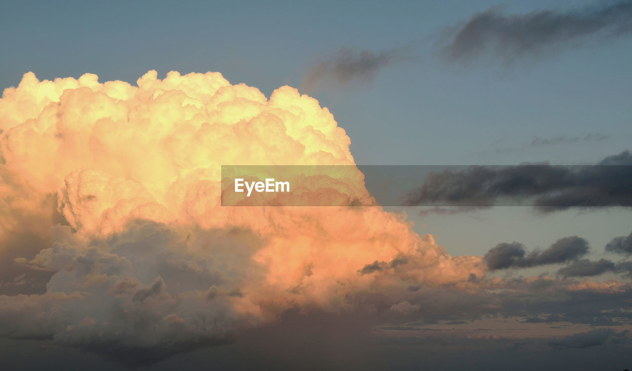cloud - sky, sky, nature, sunset, beauty in nature, tranquility, atmospheric mood, cloudscape, dramatic sky, scenics, no people, outdoors, environment, tranquil scene, sky only, low angle view, day