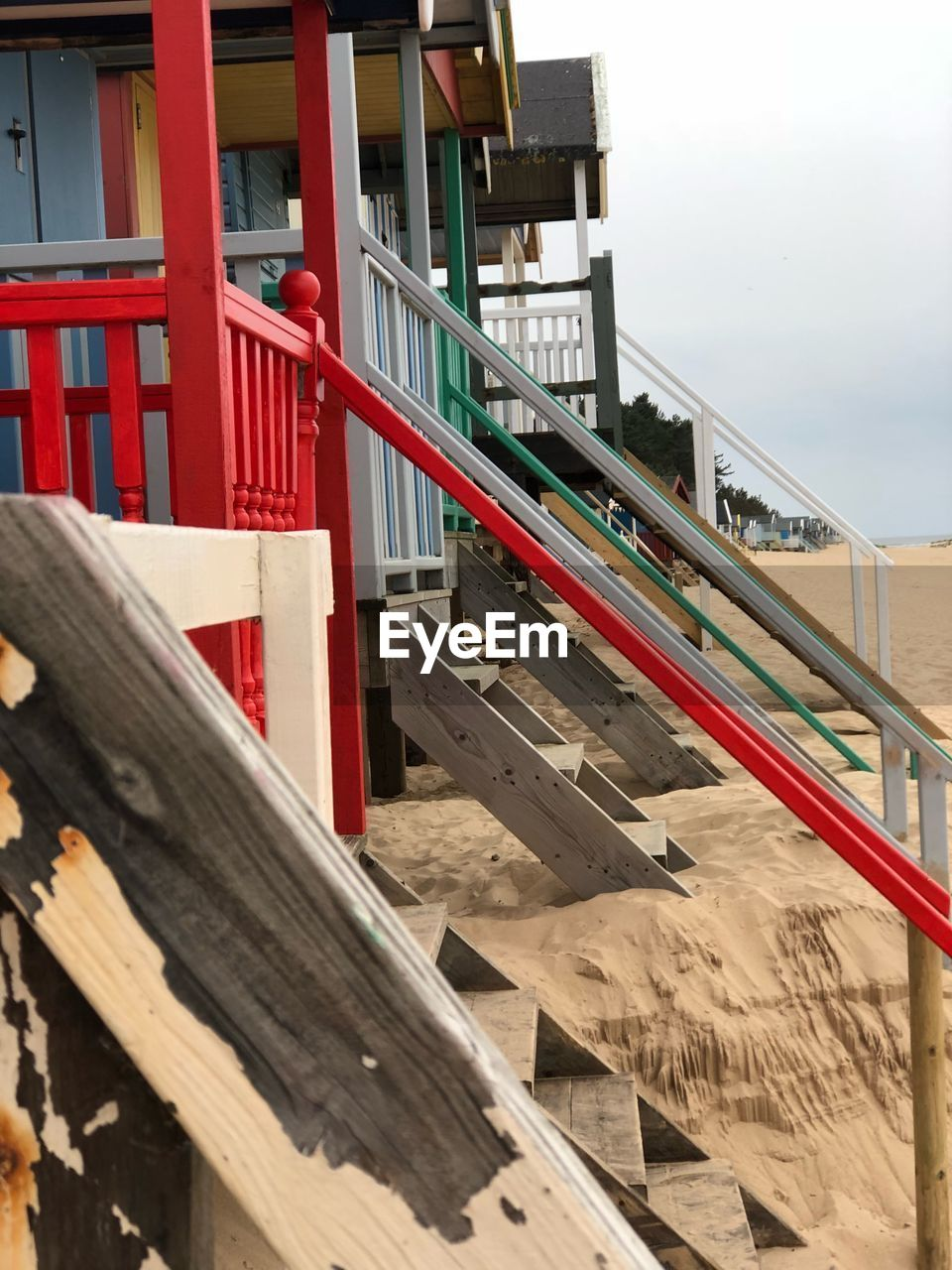 architecture, built structure, wood - material, railing, red, no people, day, nature, building exterior, staircase, outdoors, metal, sky, barrier, wood, construction industry, transportation, bridge, connection, construction site