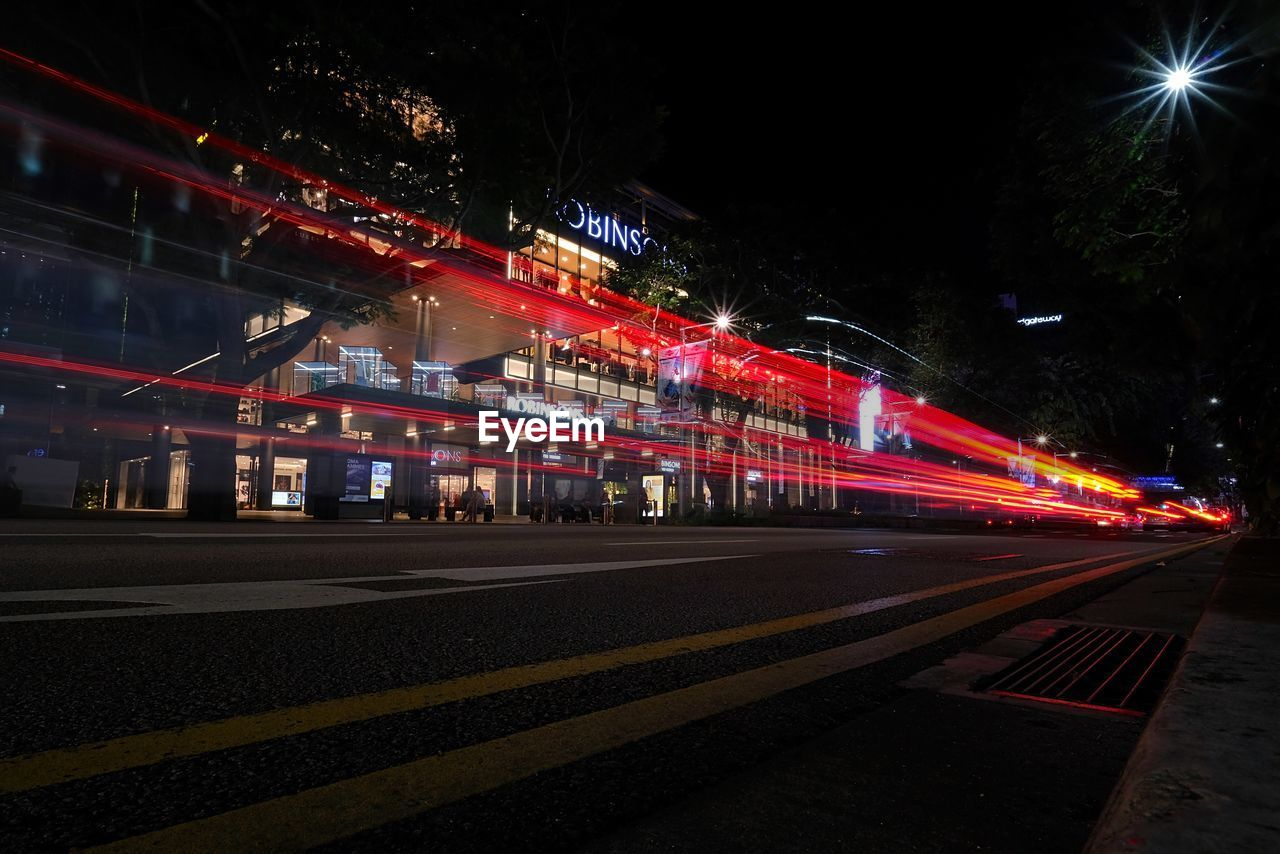 night, illuminated, long exposure, light trail, speed, blurred motion, motion, road, transportation, street, high street, outdoors, multi colored, urban scene, no people, building exterior, architecture, city, sky