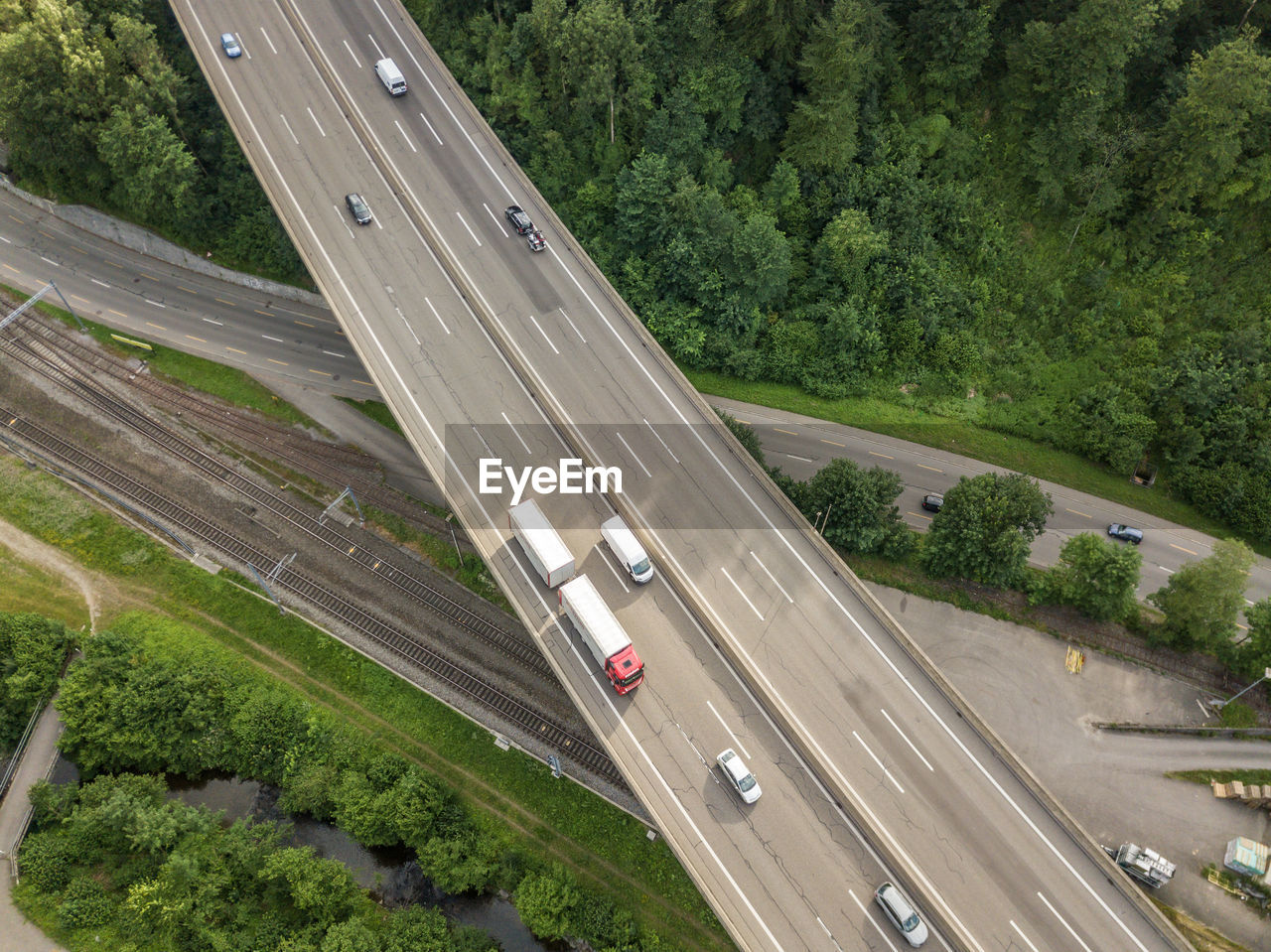 transportation, road, highway, land vehicle, high angle view, mode of transportation, tree, plant, motion, no people, nature, car, motor vehicle, day, traffic, multiple lane highway, outdoors, travel, city, truck