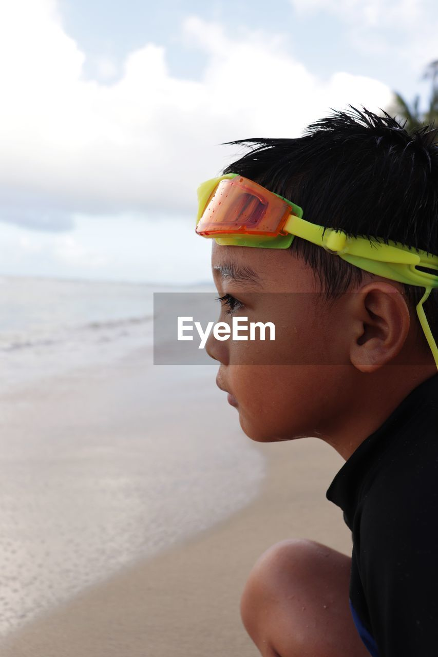Portrait of boy on the beach in summertime.