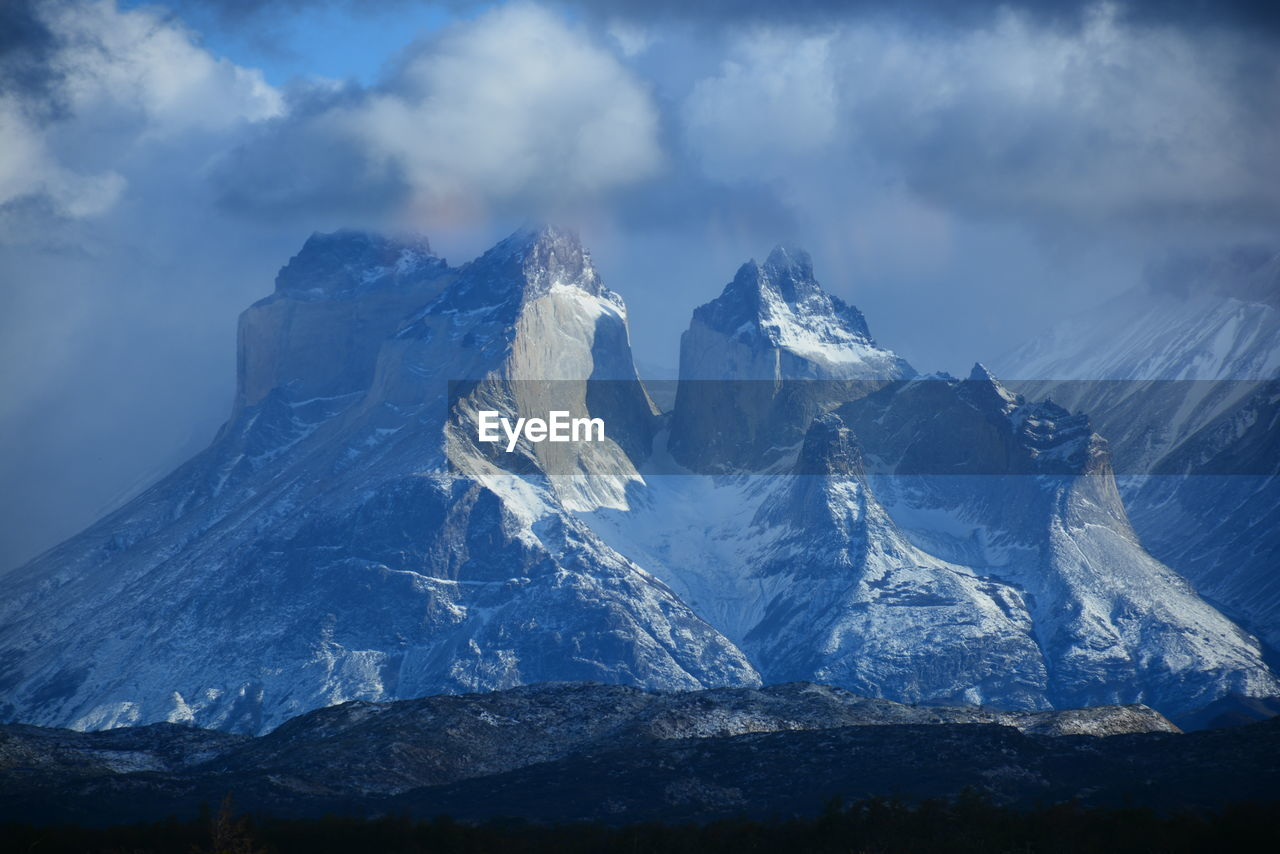 mountain, cloud - sky, snow, sky, cold temperature, winter, scenics - nature, beauty in nature, mountain range, mountain peak, environment, tranquil scene, landscape, snowcapped mountain, nature, tranquility, no people, non-urban scene, geology, formation