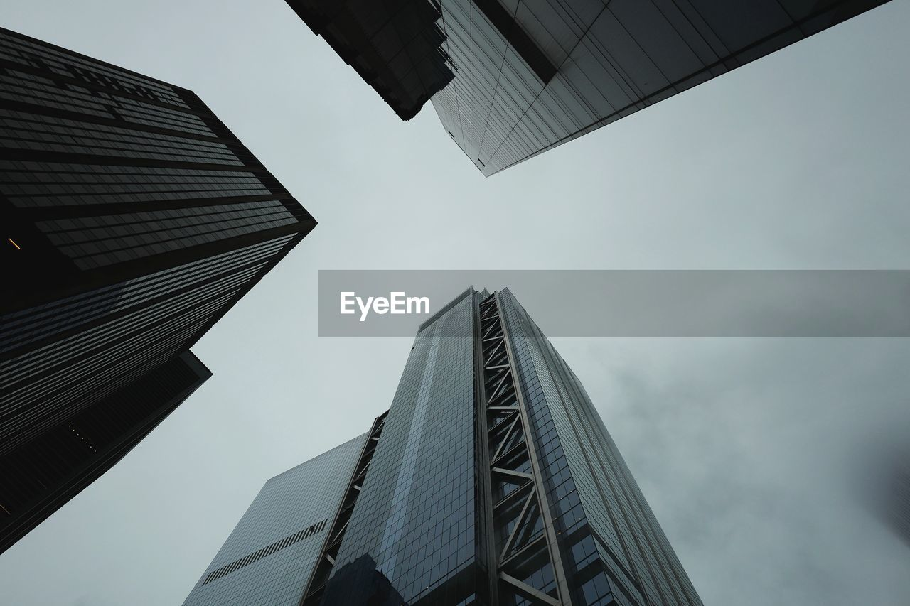 low angle view, architecture, sky, built structure, building exterior, building, office building exterior, city, office, skyscraper, tall - high, no people, nature, day, modern, outdoors, tower, directly below, cloud - sky, business, financial district