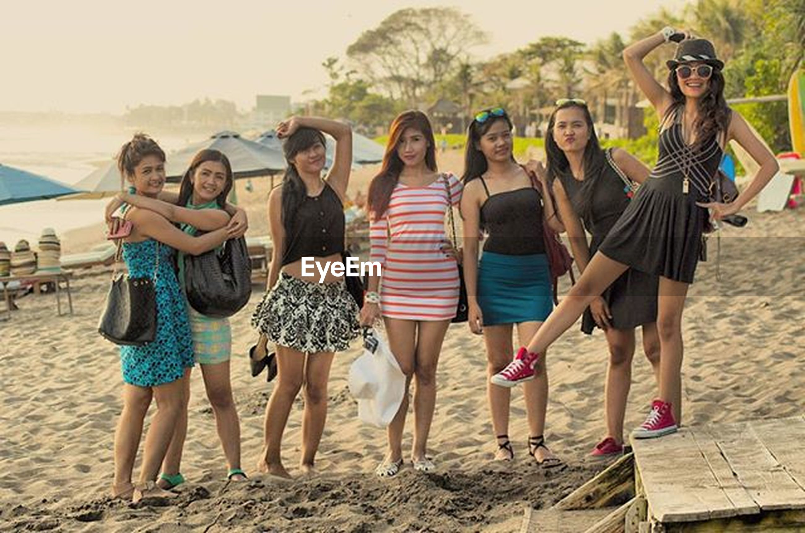 togetherness, lifestyles, leisure activity, bonding, friendship, love, casual clothing, person, happiness, vacations, full length, beach, enjoyment, young adult, young men, smiling, standing