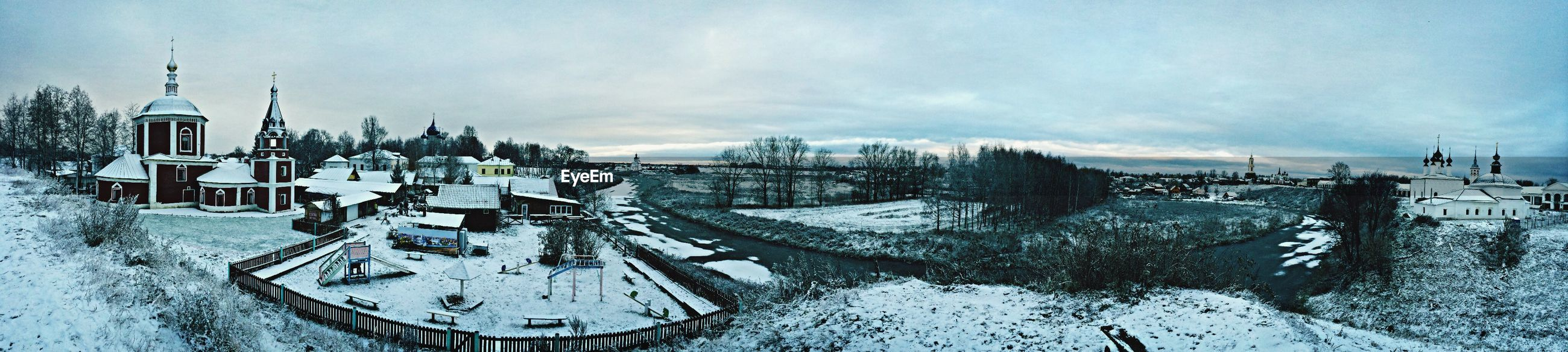 snow, winter, cold temperature, season, sky, weather, water, frozen, cloud - sky, building exterior, panoramic, built structure, covering, architecture, nature, transportation, tree, day, mode of transport, outdoors