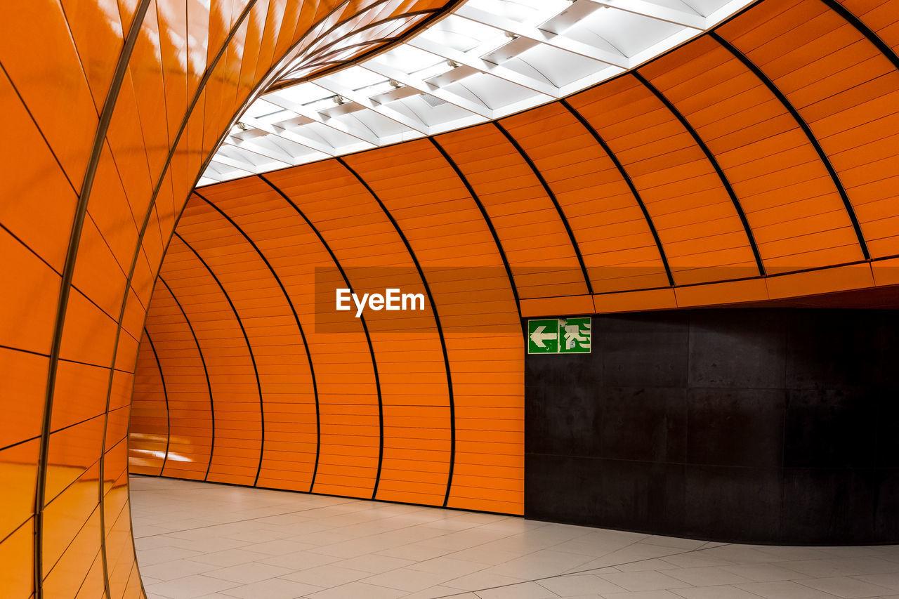Illuminated orange walls in subway