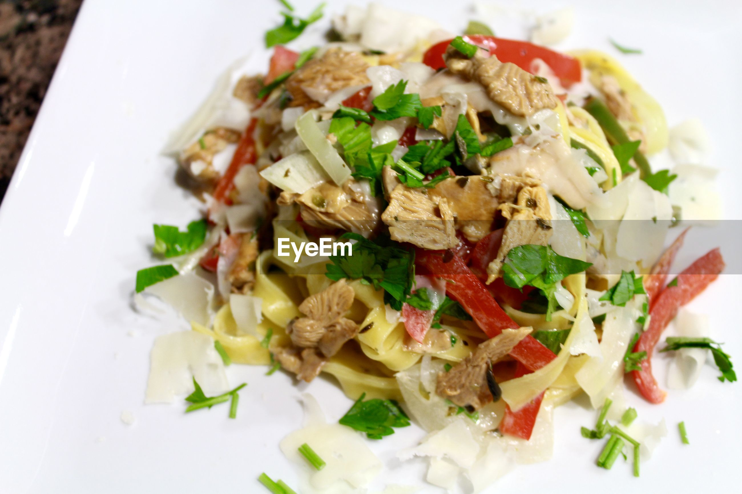 High angle view of pasta with vegetables in plate
