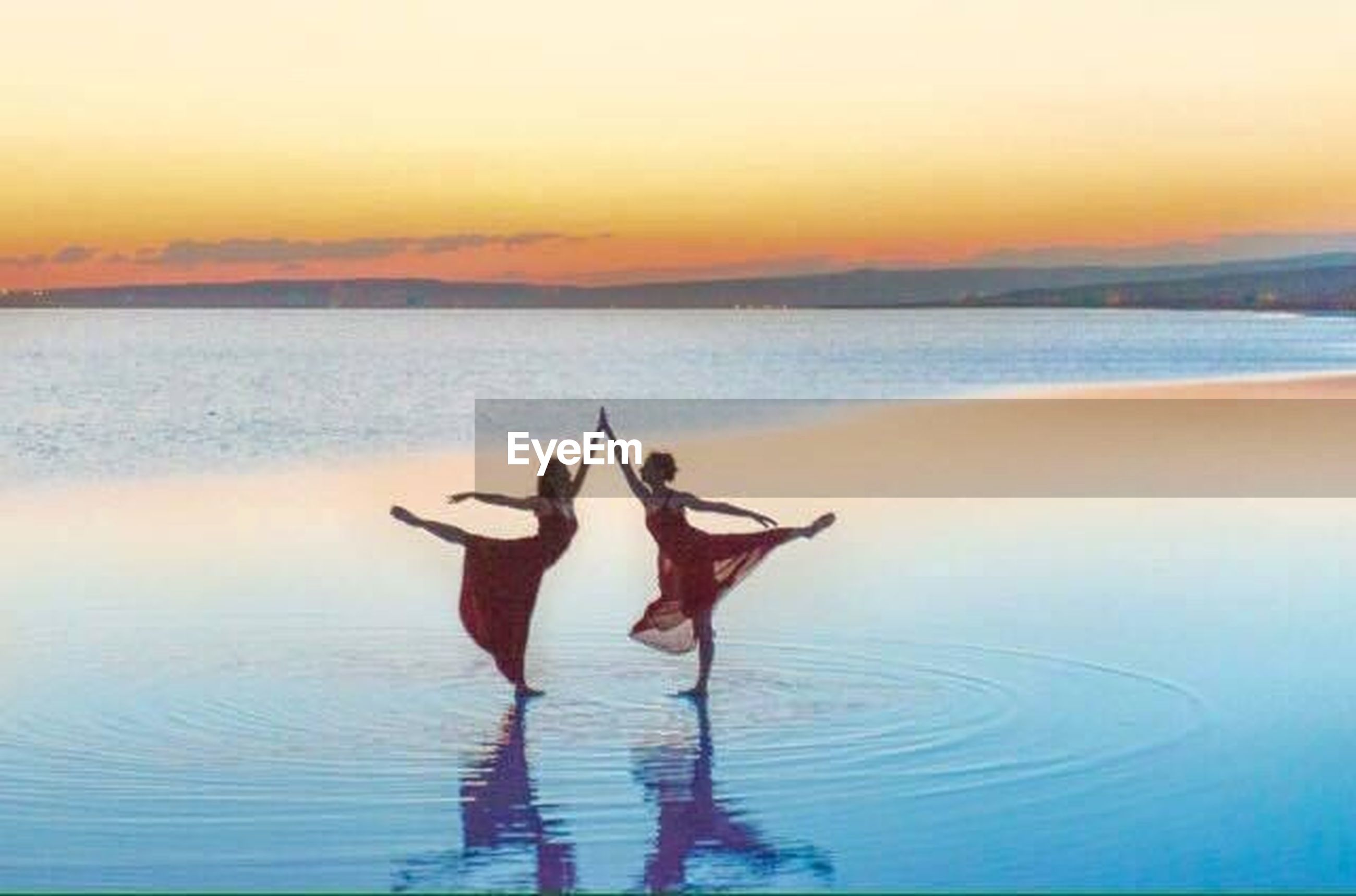 water, sky, sunset, sea, leisure activity, lifestyles, nature, two people, adult, beauty in nature, people, real people, togetherness, human body part, orange color, human arm, women, waterfront, tranquility, arms raised, swimming pool
