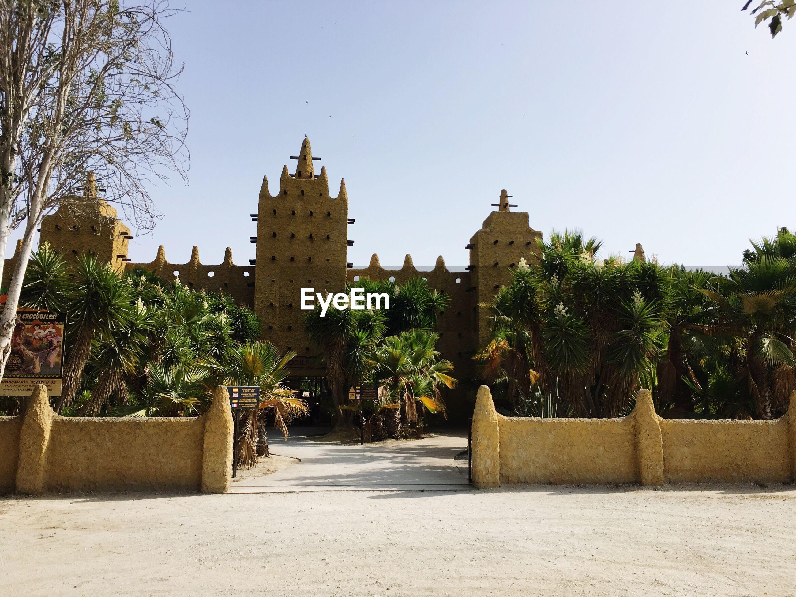Entrance of crocodile park against sky