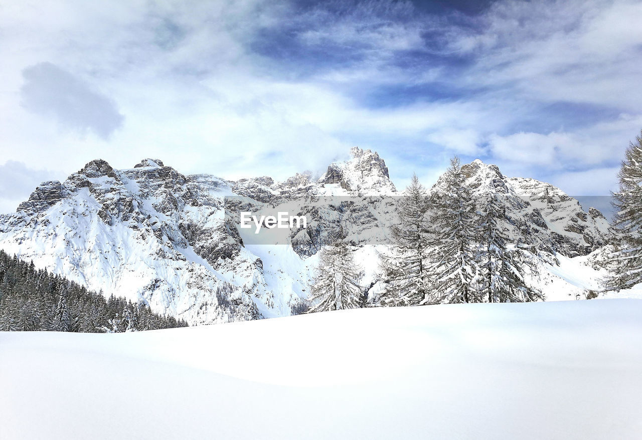winter, cold temperature, cloud - sky, snow, mountain, sky, beauty in nature, scenics - nature, tranquil scene, snowcapped mountain, tranquility, nature, day, mountain range, tree, plant, non-urban scene, no people, white color, mountain peak