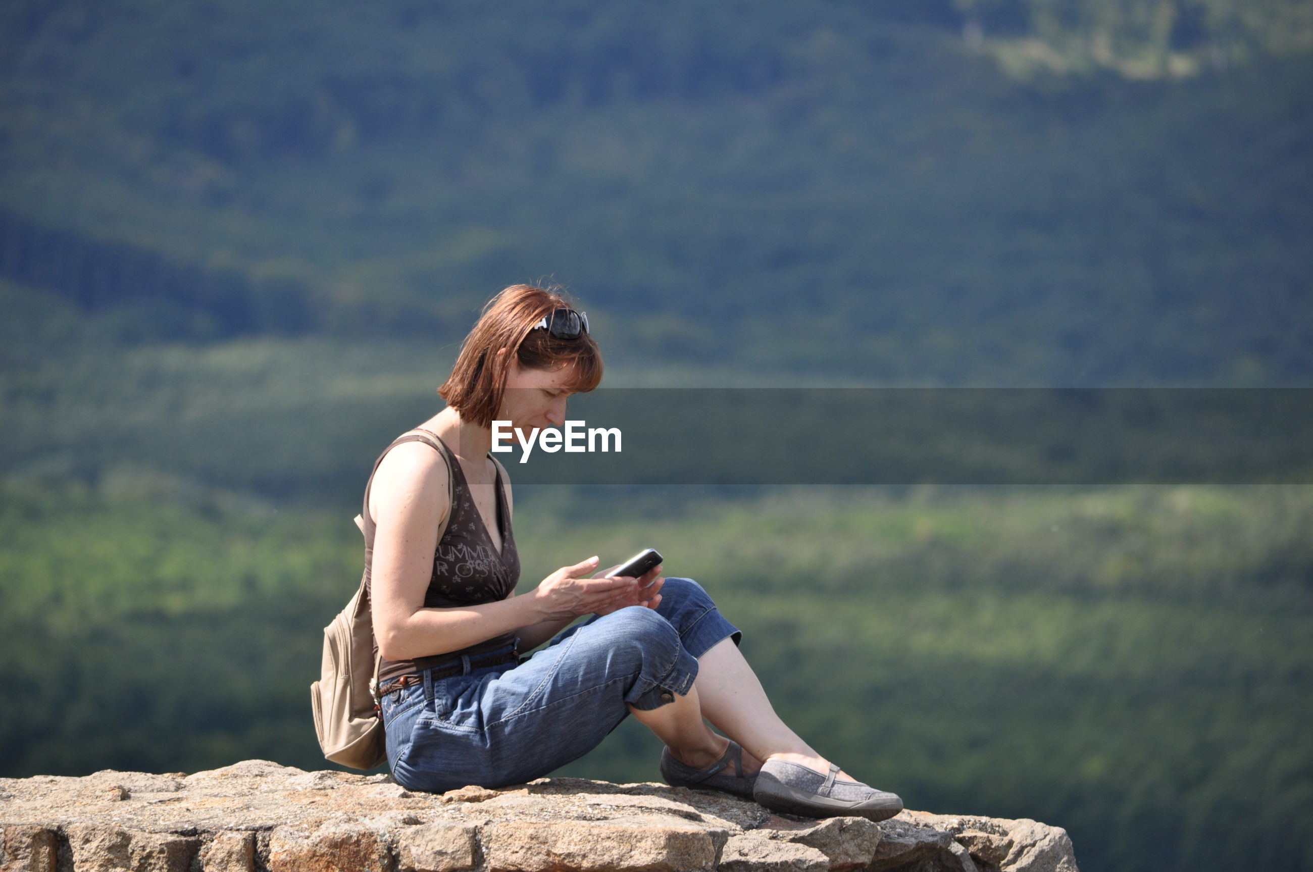 Portrait of woman sitting on mountain