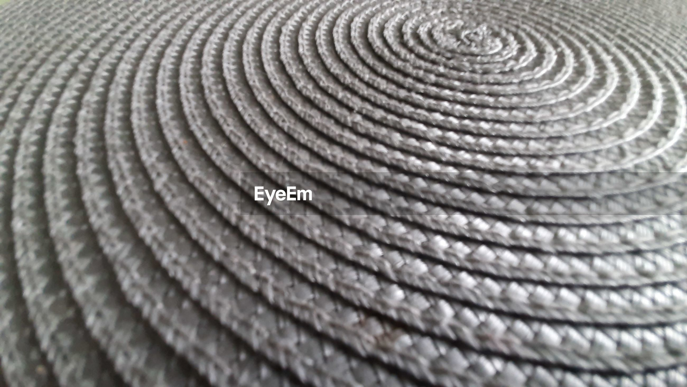 FULL FRAME SHOT OF SPIRAL PATTERN ON TEXTURED SURFACE