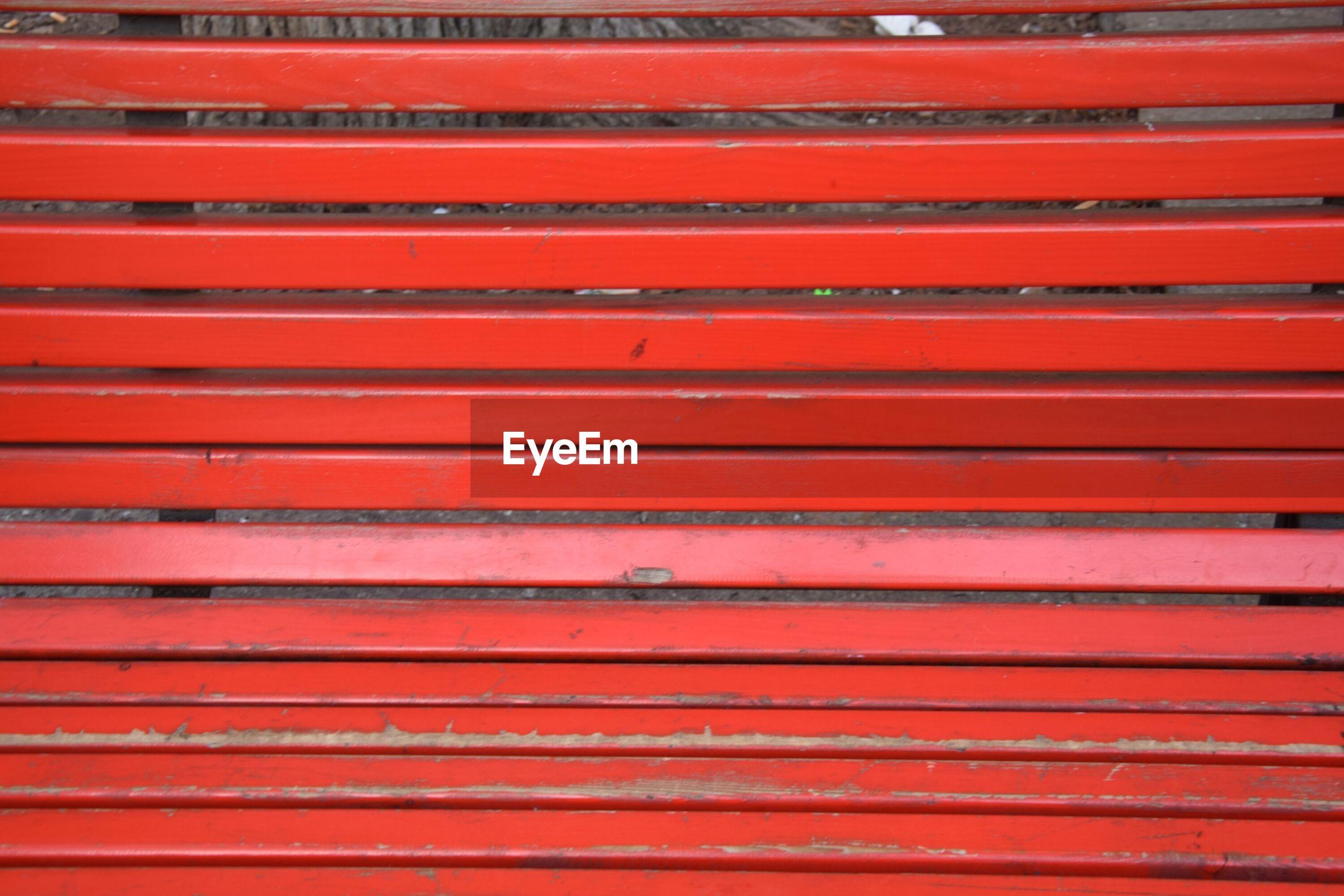 Full frame shot of red bench