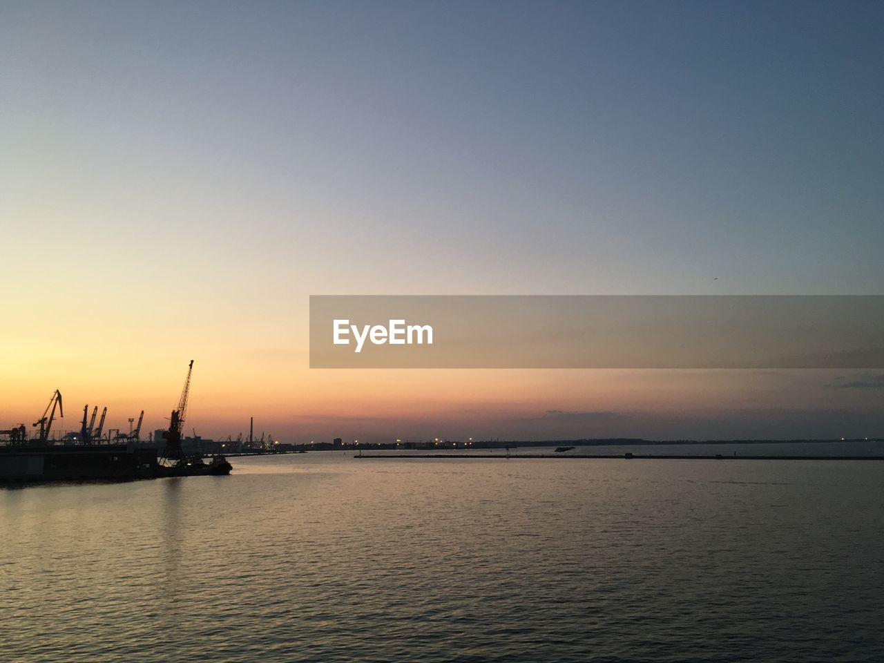 sunset, water, nature, sea, beauty in nature, waterfront, scenics, silhouette, tranquility, tranquil scene, sky, nautical vessel, outdoors, no people, horizon over water, day, drilling rig