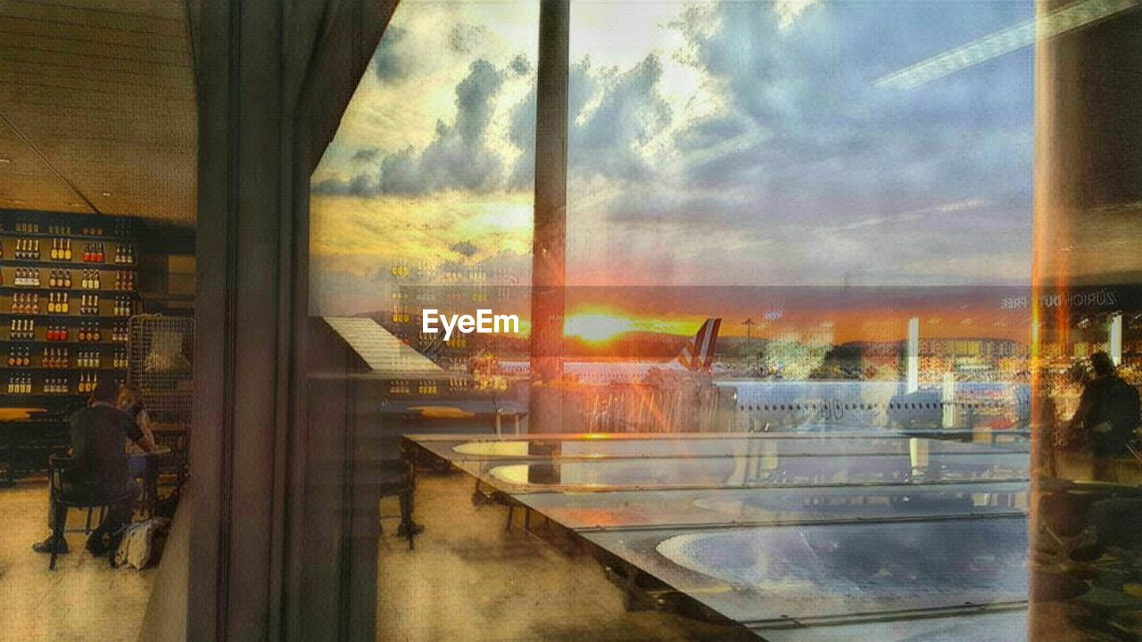 window, sunset, transportation, sky, architecture, built structure, indoors, no people, day, building exterior