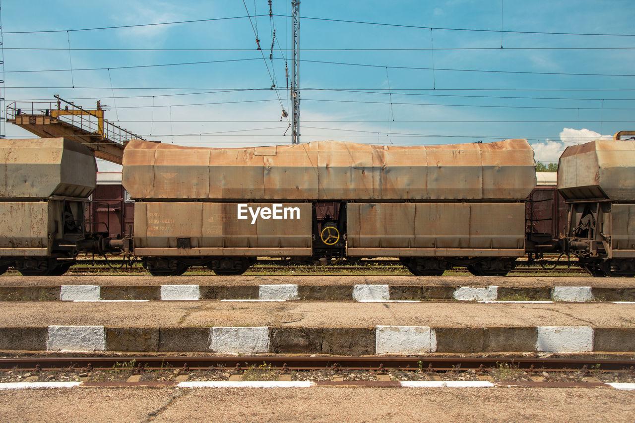 TRAIN AGAINST RAILROAD TRACKS