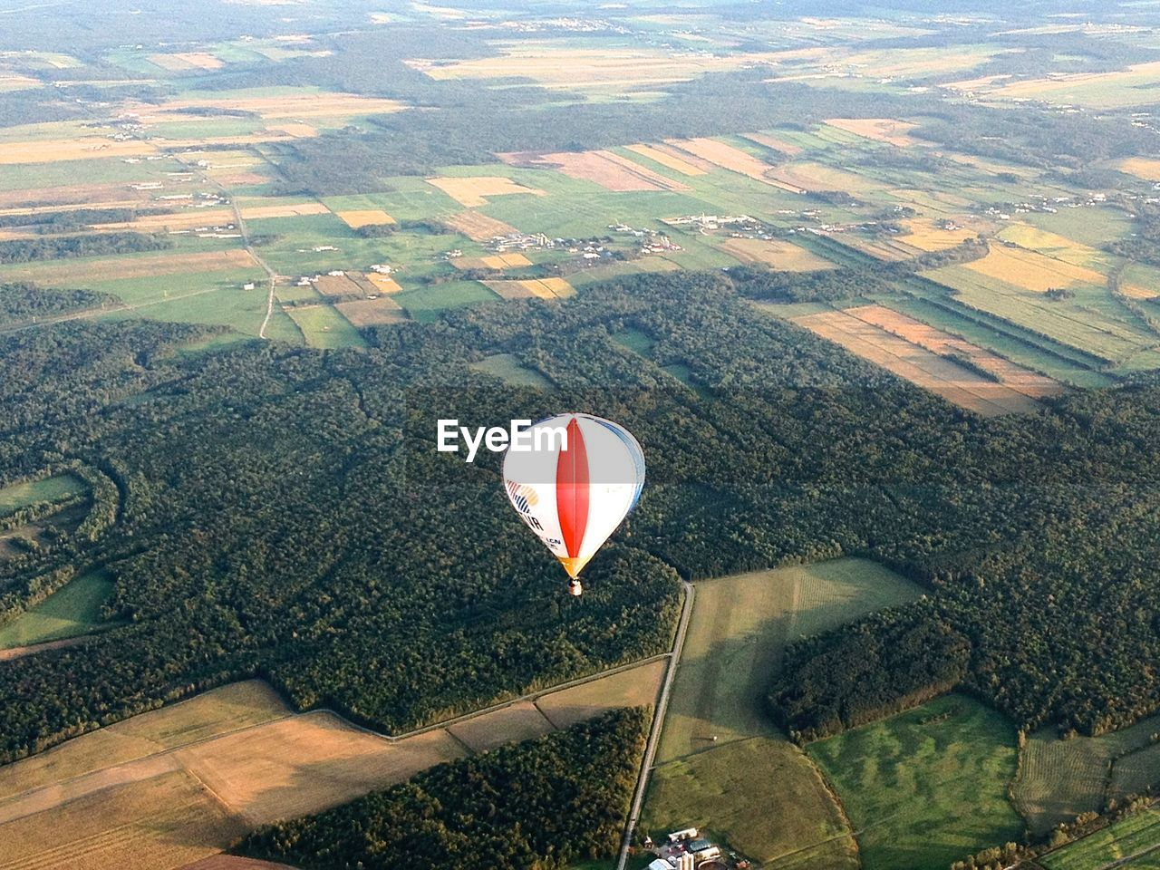 Aerial view of hot air balloon and rural landscape