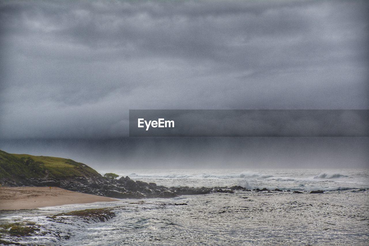 cloud - sky, sky, sea, beauty in nature, scenics - nature, storm, water, overcast, nature, storm cloud, tranquility, beach, day, horizon, land, no people, tranquil scene, horizon over water, outdoors, power in nature, ominous