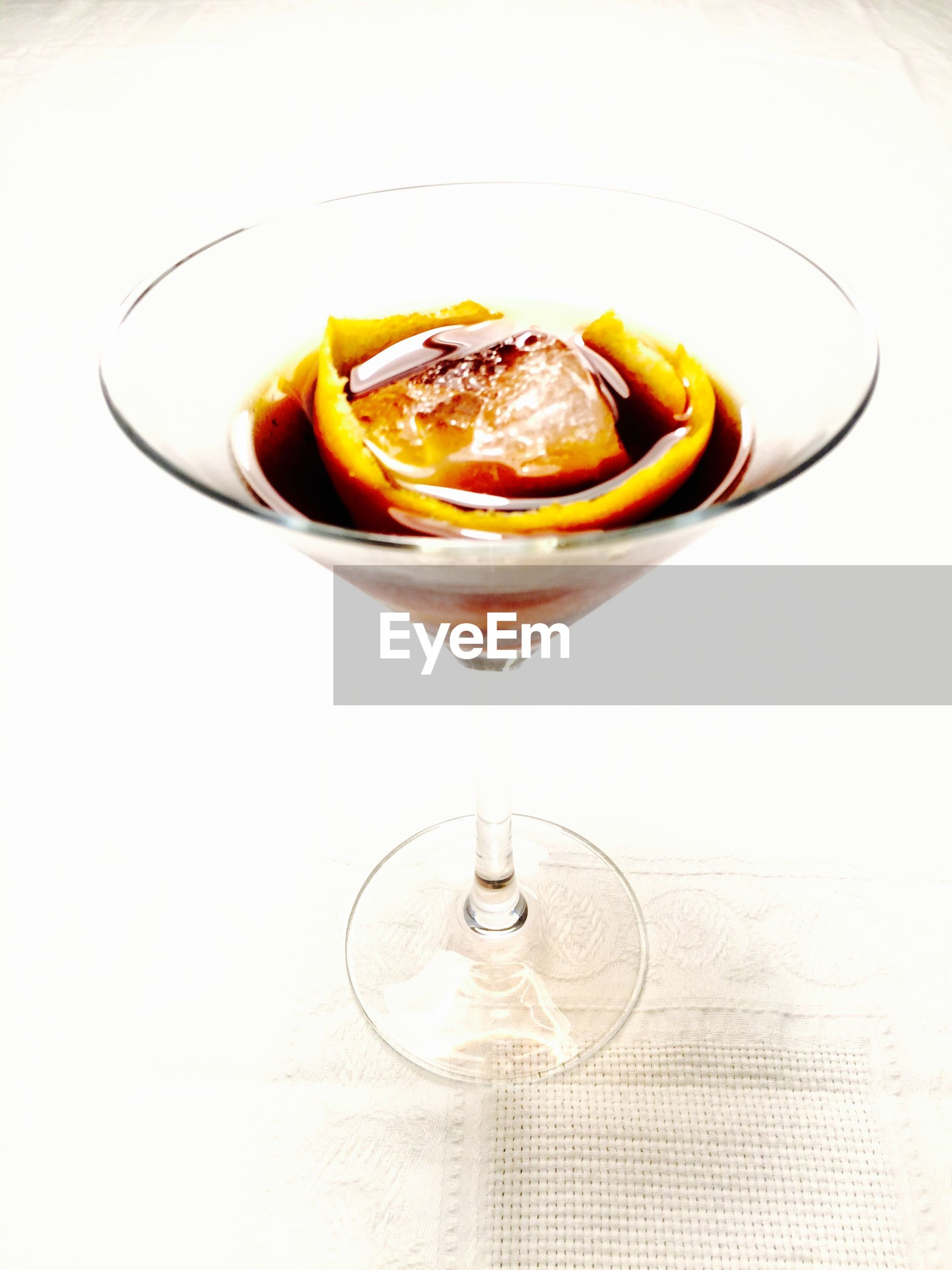 Close-up of cocktail in martini glass against white background