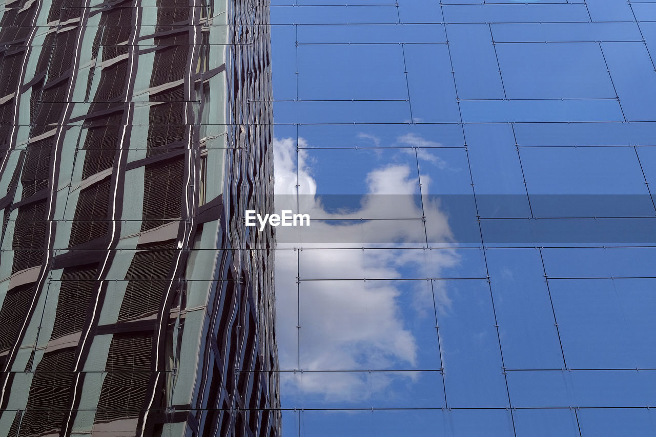 building exterior, built structure, architecture, building, low angle view, office, reflection, city, modern, sky, cloud - sky, day, no people, office building exterior, glass - material, nature, outdoors, window, blue, tall - high, skyscraper
