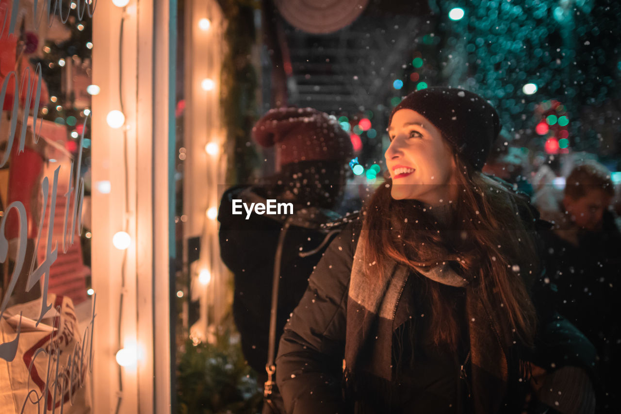 Woman Looking At Store Window During Christmas