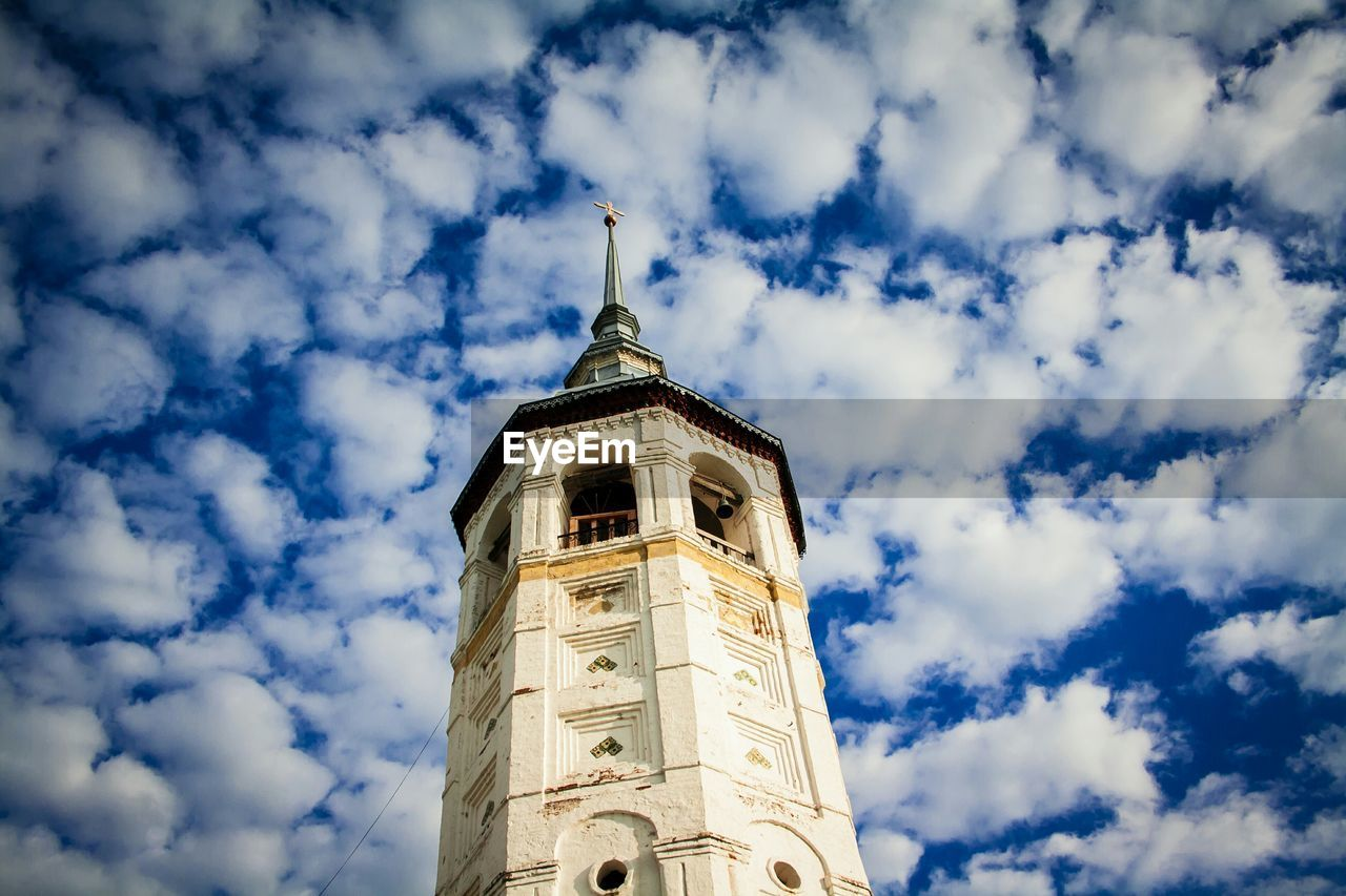 Low Angle View Of Bell Tower Against Clouds