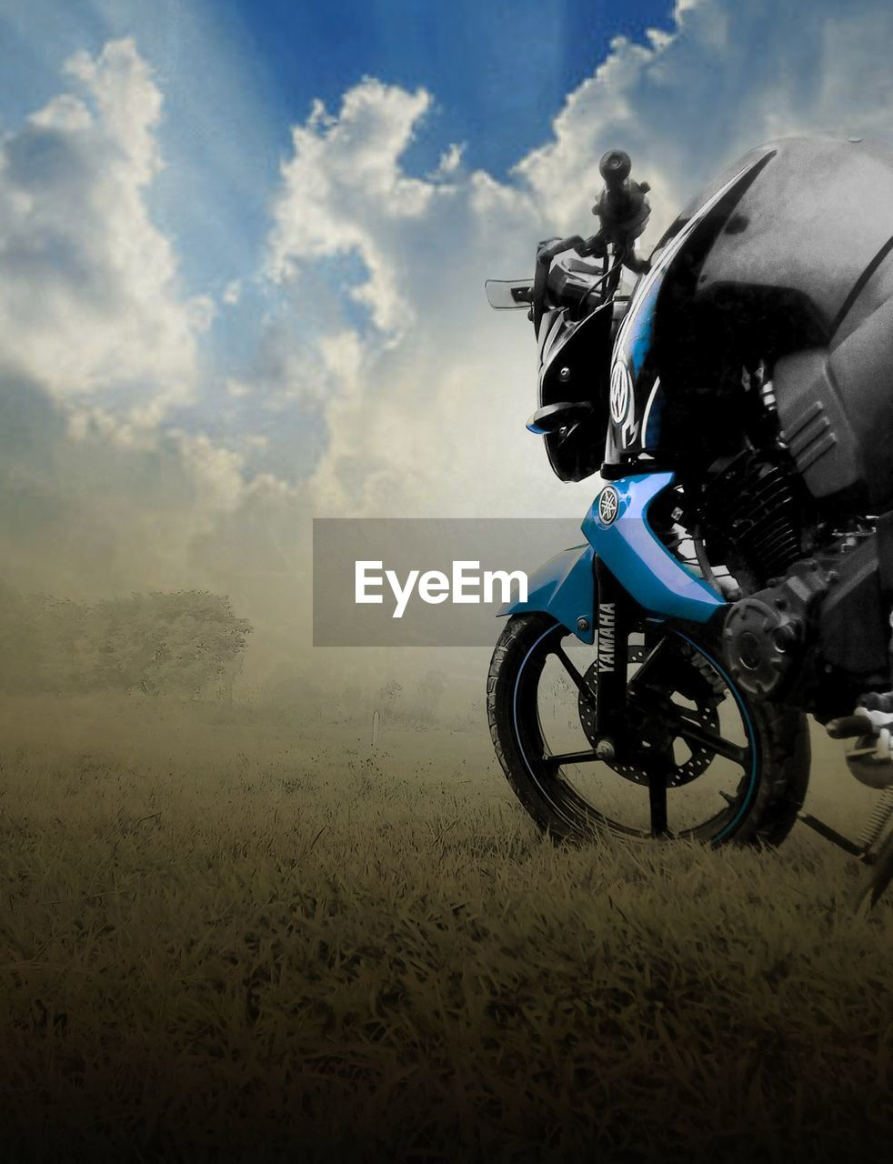 motorcycle, one person, cloud - sky, helmet, sky, speed, motorsport, transportation, riding, mode of transport, adventure, full length, sports helmet, crash helmet, competition, grass, field, motion, outdoors, sports race, motocross, headwear, day, one man only, competitive sport, people, nature, extreme sports, sports track, adult, adults only