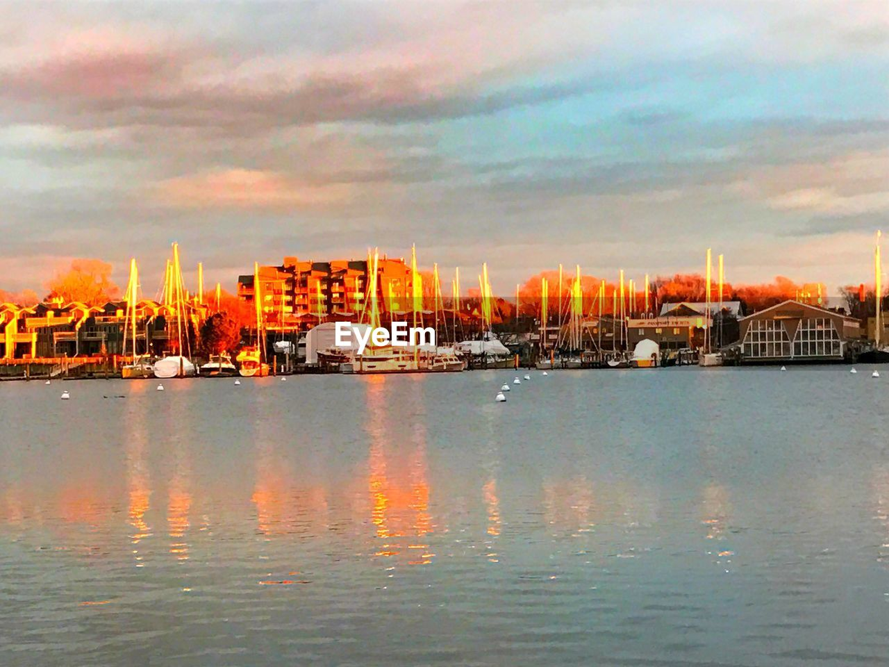 sky, water, waterfront, built structure, sea, architecture, nautical vessel, cloud - sky, building exterior, no people, transportation, sunset, outdoors, nature, city, moored, cityscape, scenics, yacht, beauty in nature, day