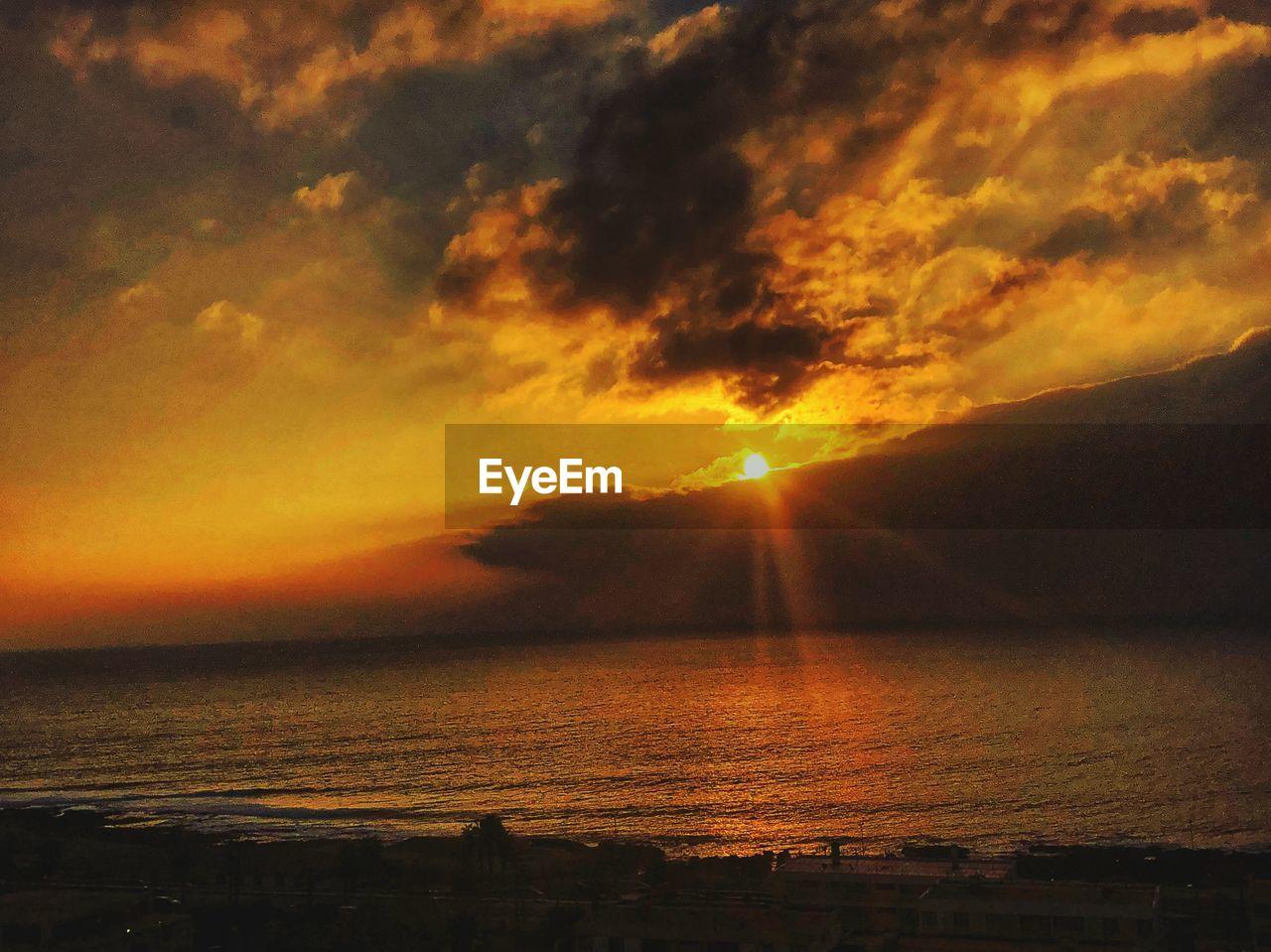 sky, sunset, cloud - sky, water, beauty in nature, scenics - nature, sea, tranquility, tranquil scene, orange color, sun, sunlight, sunbeam, horizon over water, horizon, nature, no people, idyllic, lens flare, outdoors