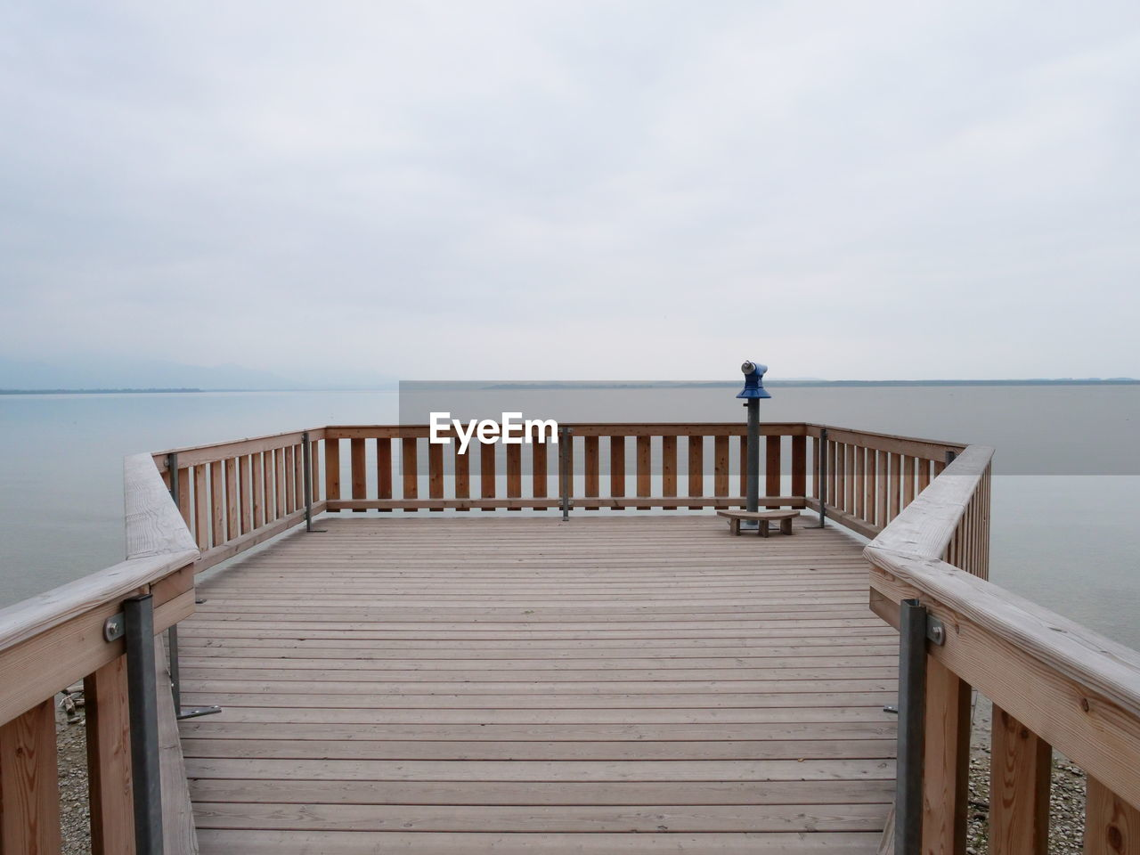 sky, railing, water, horizon over water, horizon, sea, scenics - nature, beauty in nature, cloud - sky, tranquil scene, nature, wood - material, tranquility, pier, day, architecture, built structure, idyllic, one person, outdoors, wood paneling