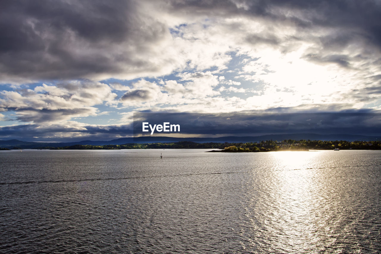 cloud - sky, sky, water, scenics - nature, beauty in nature, tranquil scene, tranquility, waterfront, no people, sea, nature, sunlight, idyllic, non-urban scene, outdoors, day, rippled, land