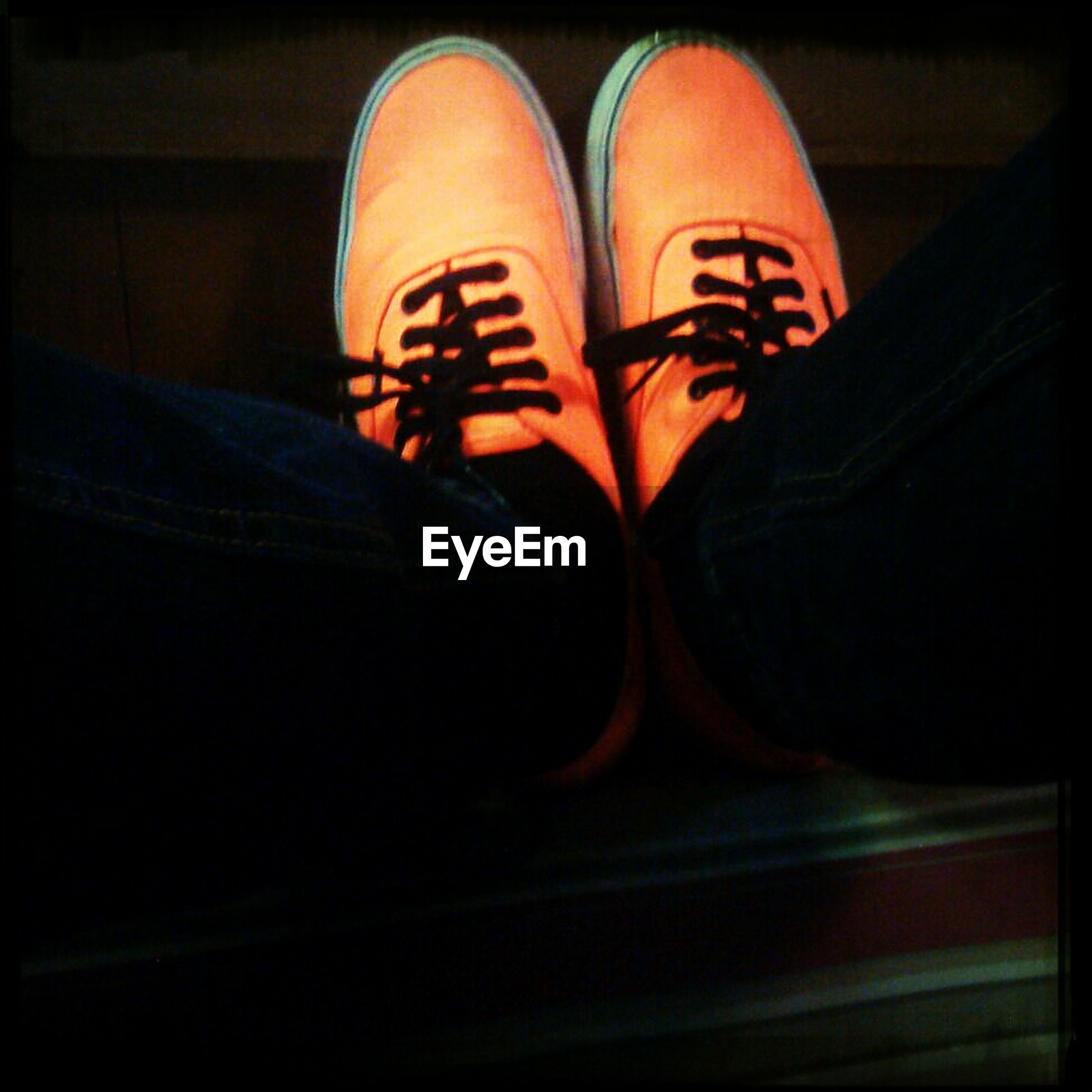 shoe, indoors, close-up, footwear, low section, personal perspective, auto post production filter, one person, person, night, pair, part of, illuminated, dark, transportation, high angle view, shadow, orange color, human representation