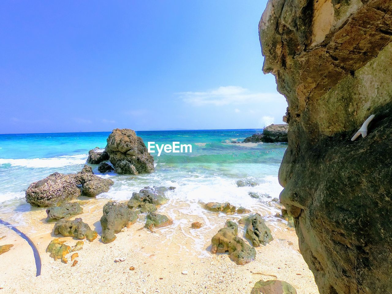 sea, rock - object, sky, beauty in nature, nature, water, horizon over water, day, scenics, blue, tranquil scene, tranquility, no people, sunlight, outdoors