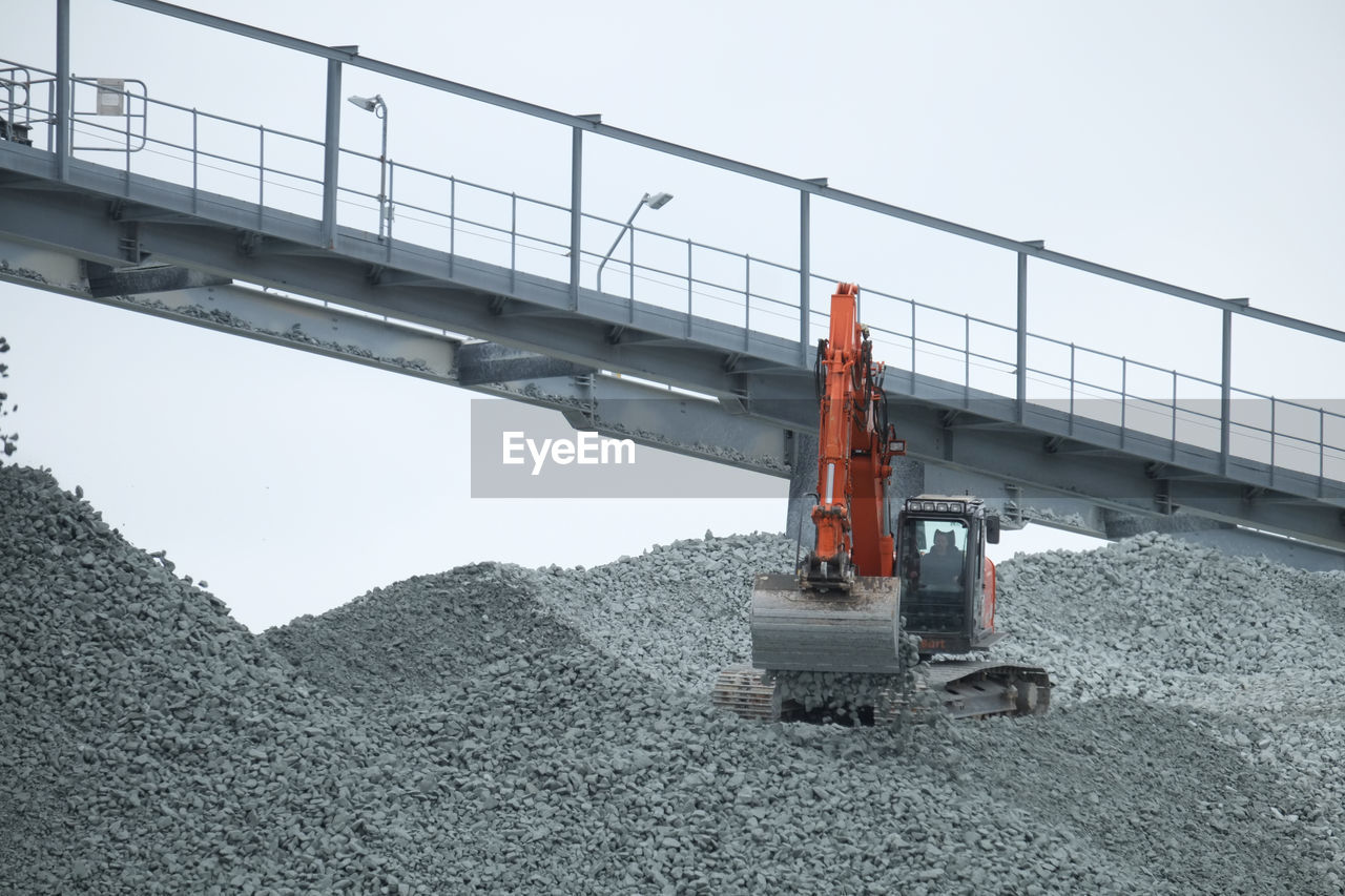 industry, transportation, construction industry, sky, machinery, construction site, nature, day, development, construction machinery, clear sky, no people, connection, outdoors, architecture, built structure, bridge, land vehicle, equipment, bridge - man made structure, quarry, construction equipment, industrial equipment