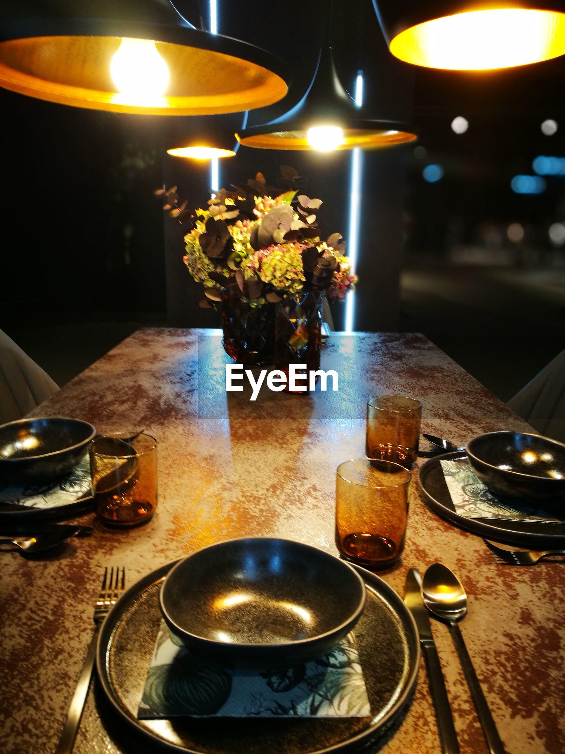 Close-up of illuminated tea light on table in restaurant