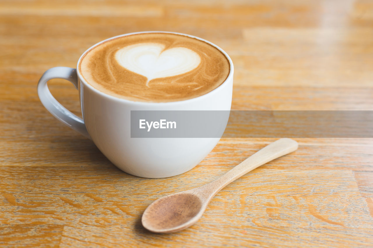 COFFEE CUP WITH SPOON ON TABLE