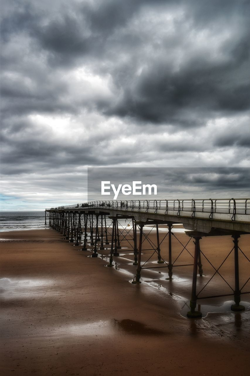 cloud - sky, sky, sea, water, land, beach, overcast, nature, scenics - nature, storm, beauty in nature, storm cloud, sand, tranquility, horizon over water, tranquil scene, no people, pier, outdoors, power in nature, ominous, long