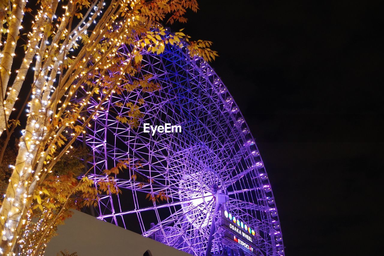 night, illuminated, amusement park, low angle view, ferris wheel, arts culture and entertainment, no people, amusement park ride, big wheel, outdoors, sky, clear sky