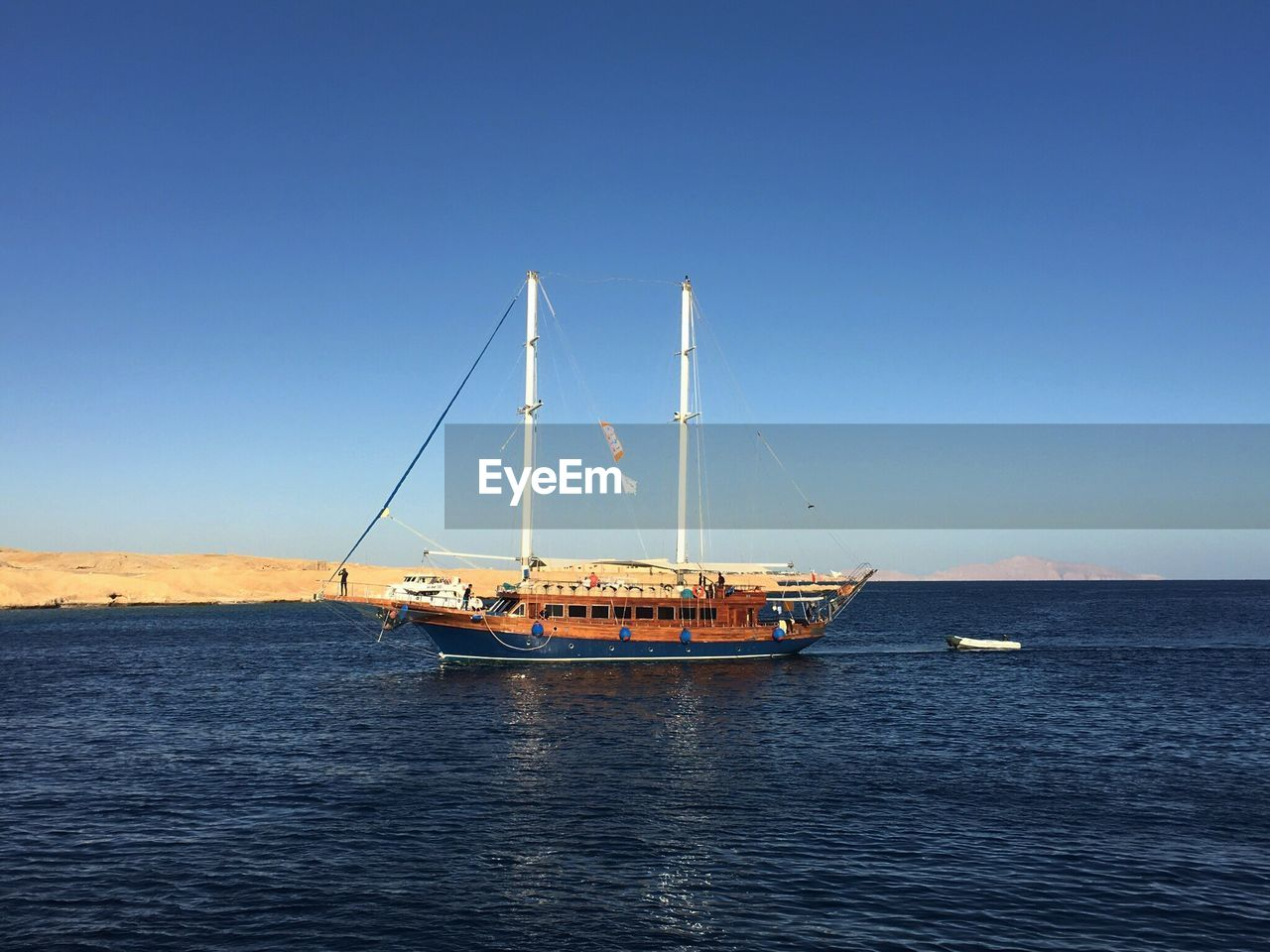 sea, transportation, nautical vessel, water, clear sky, mode of transport, waterfront, nature, no people, outdoors, blue, day, beauty in nature, scenics, horizon over water, sky