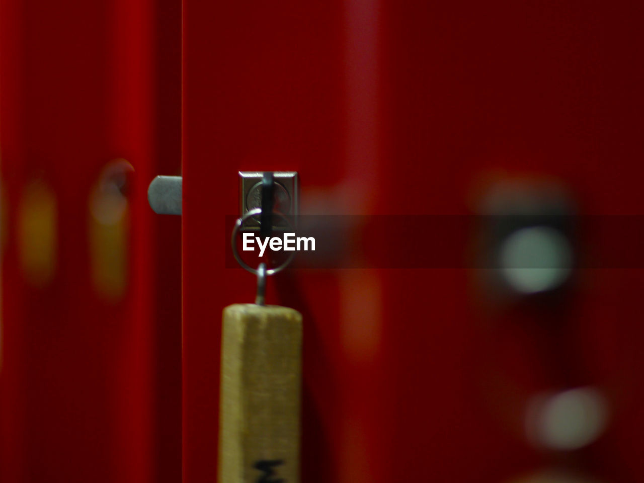 red, close-up, door, metal, hanging, no people, indoors, focus on foreground, day
